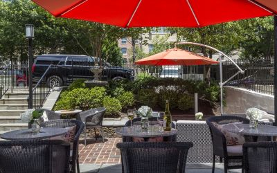 Complimentary wine hour on the shaded patio at The Normandy Hotel in Dupont Circle